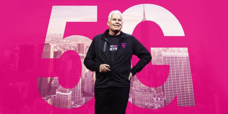 T-Mobile CTO Neville Ray stands in front of a backdrop that says,