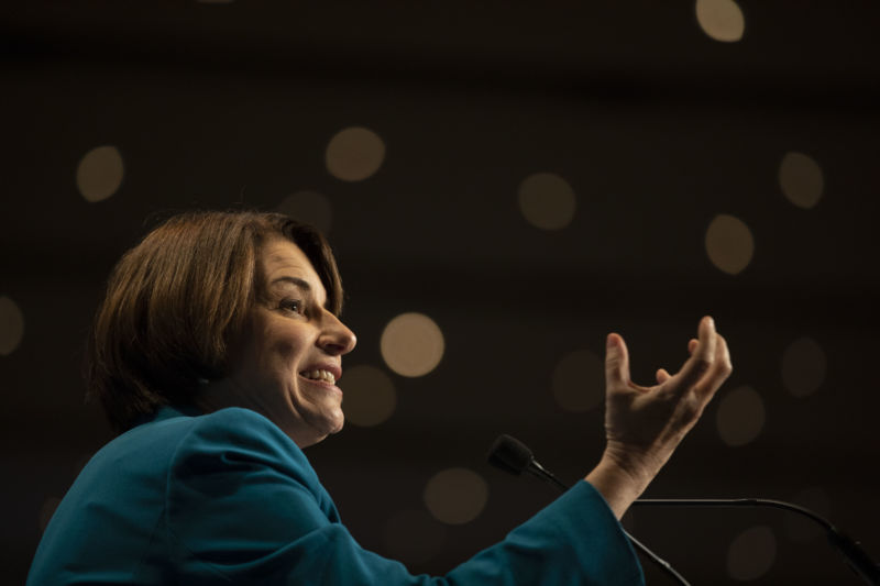A woman gestures during a presentation.