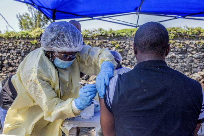 A man receives a vaccine against Ebola from a nurse outside the Afia Himbi Health Center on July 15, 2019 in Goma.