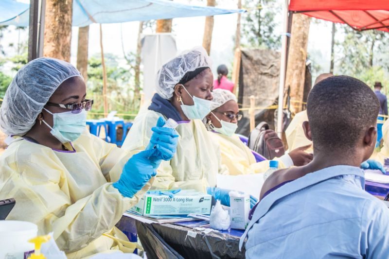 BUTEMBO, CONGO - JULY 27: A healthcare member inoculates a man for Ebola suspicion to take precautions against the disease in Butembo, Democratic Republic of the Congo.