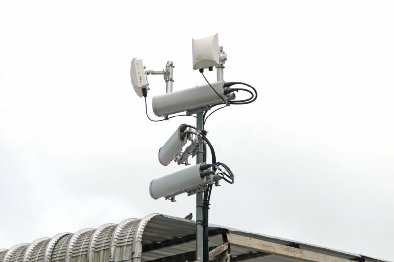 """You really can find anything in a stock image library: """"Antennas of mobile cellular systems with Wi-Fi hot spot repeater and blue sky."""""""