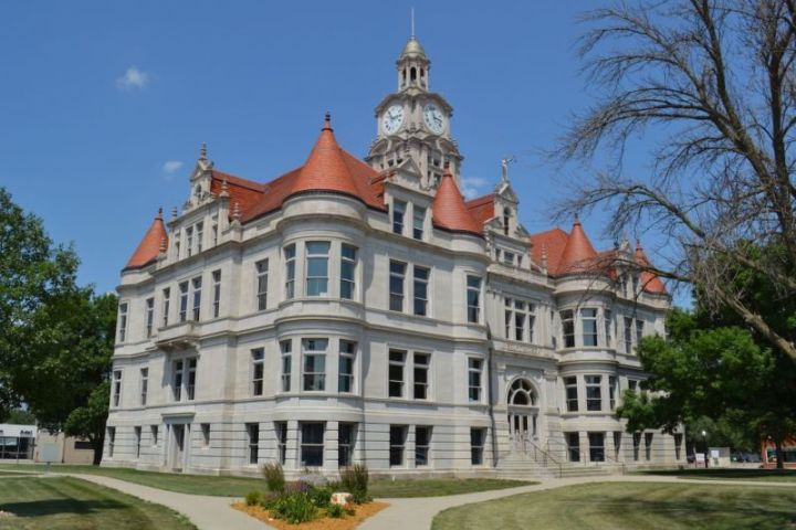 Three-story courthouse with corner gables.