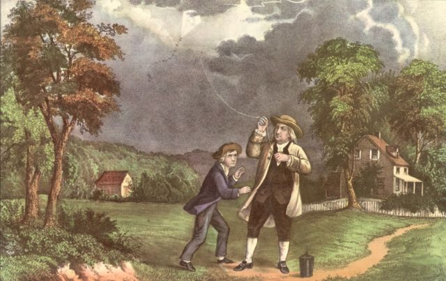 A Currier & Ives lithograph of Benjamin Franklin and his son William using a kite and key during a storm to prove that lightning was electricity, June 1752.