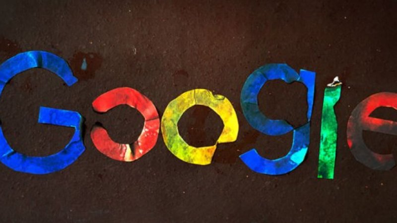 Photo of the Google logo but each letter is burned or damaged