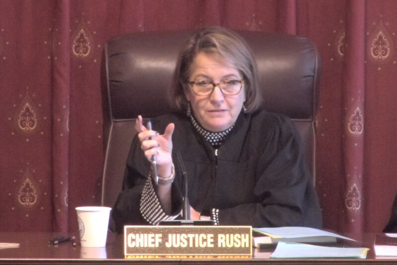 A woman in judicial robes pontificates.