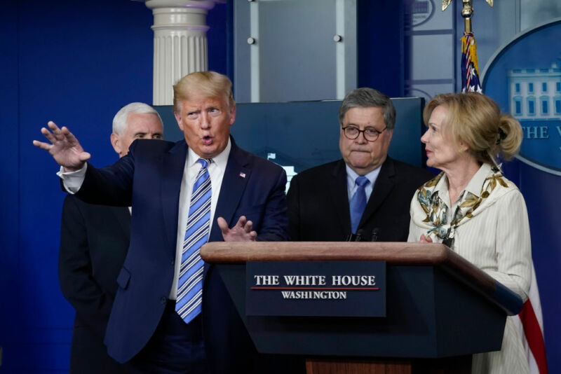 Image of President Trump gesturing during a press conference.