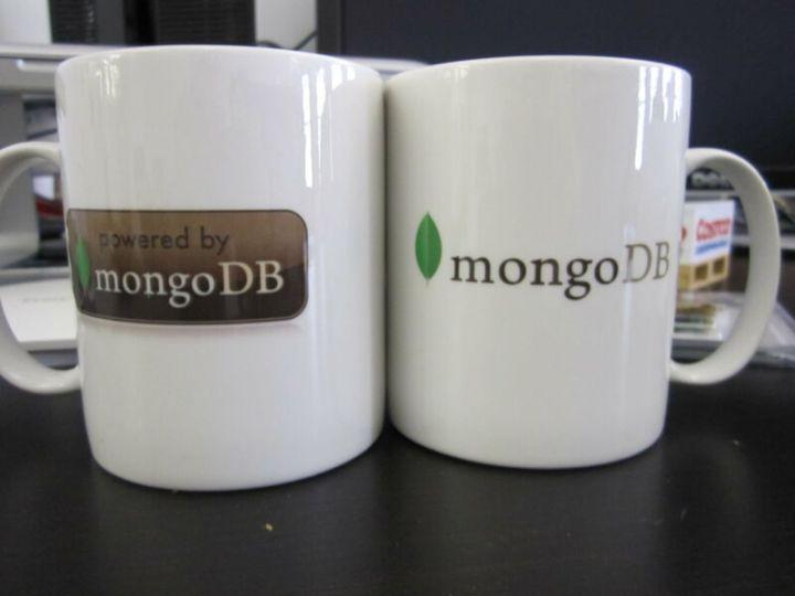 Coffee mugs with MongoDB logos on them.
