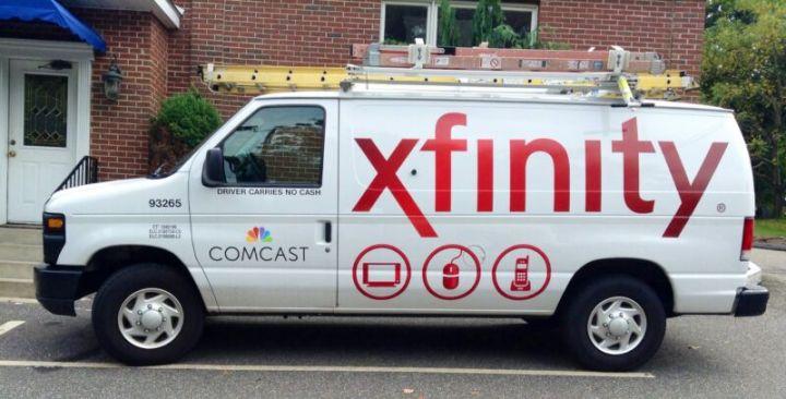 A Comcast service van parked outside a residence.