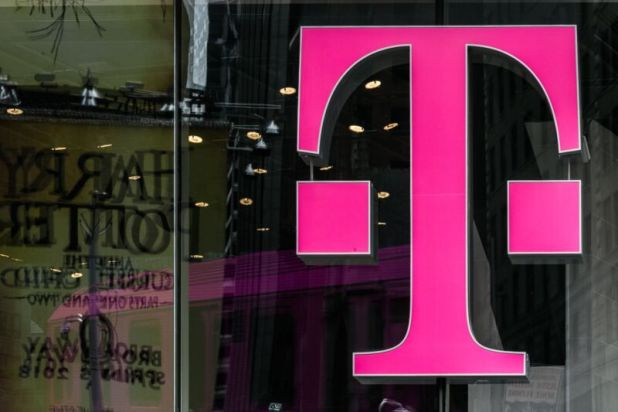 A T-Mobile logo in a store window.