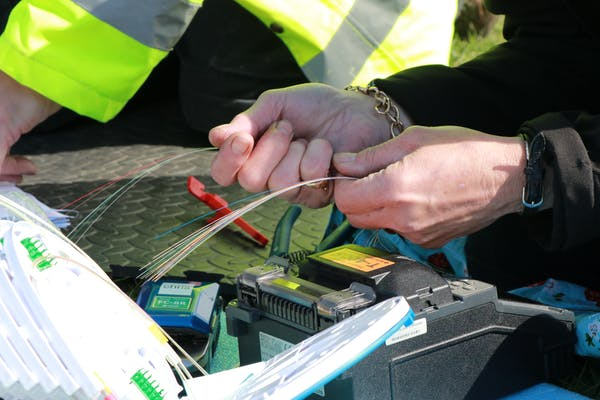 Preparing fiber-optic cable for fusing.