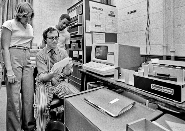 "Programmer power, indeed. (Here's a Tufts computer group sometime in the mid to late 1970. Getty caption explicitly states, ""Note equipment and 1970s fashions."")"