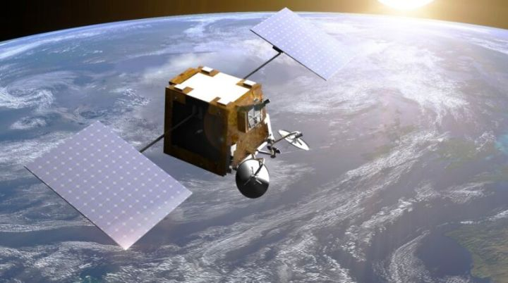 Illustration of a OneWeb satellite orbiting the Earth.