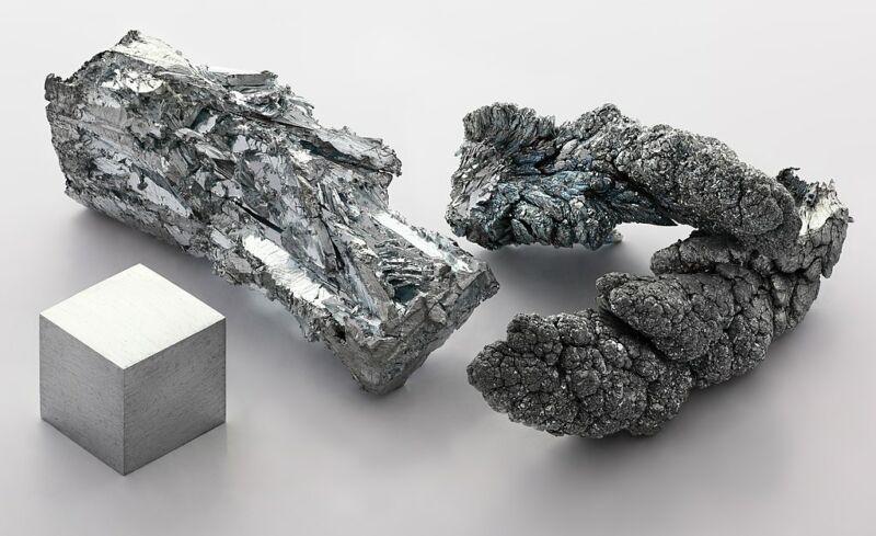 Image of three chunks of zinc metal.