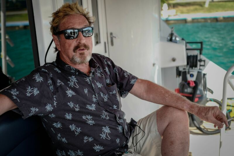 A casually dressed and sunweathered man reclines with a cigarette on a yacht.