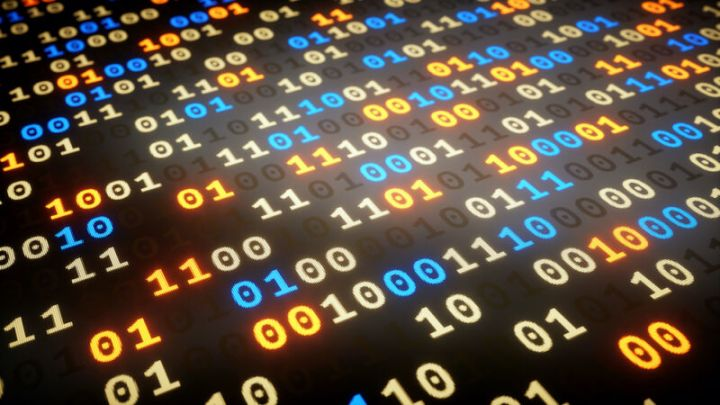 Stock photo of ones and zeros displayed across a computer screen.