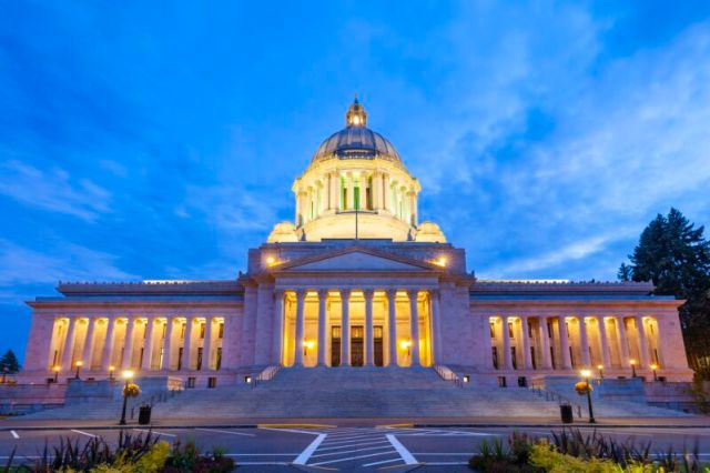 The front of the Washington state Capitol building seen during daytime.