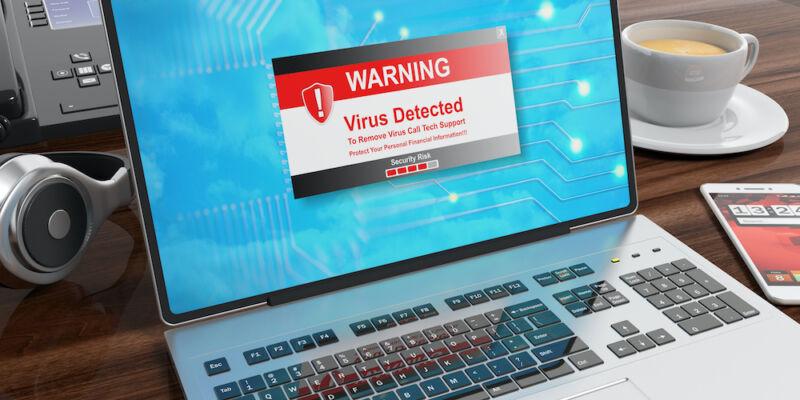 Stock photo of a virus alert on a laptop screen.