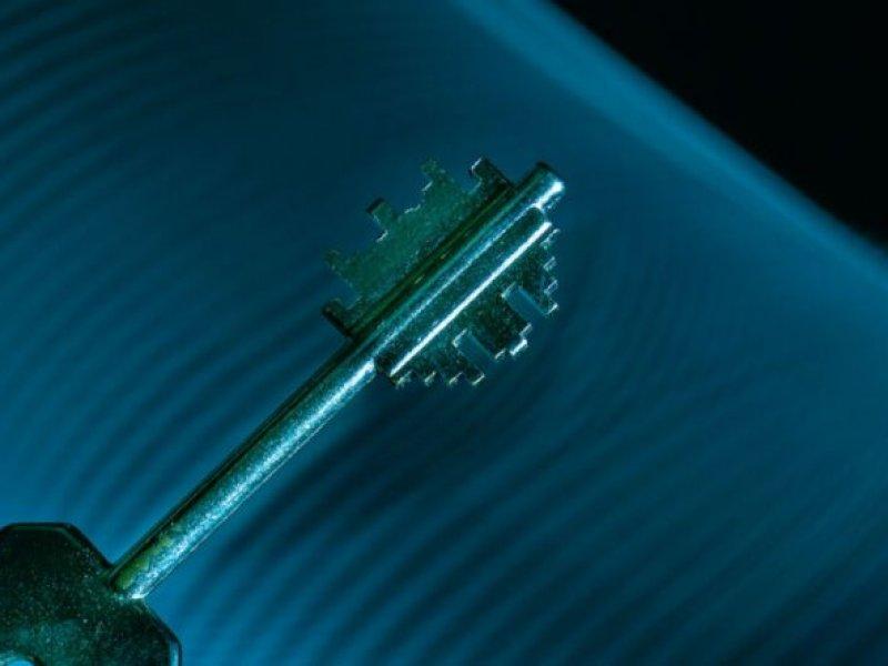 Close-up of an armored door key.