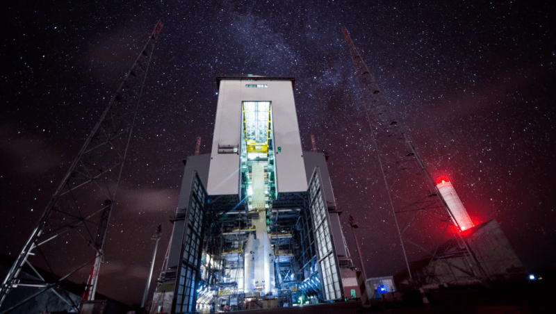 Night time at a giant rocket hanger.