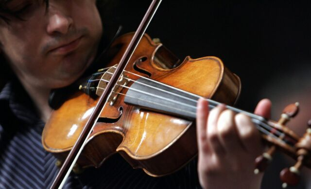 "Violinist Adrian Pintea plays a 1729 Stradivari known as the ""Solomon, Ex-Lambert"" in 2007 at Christie's in New York."