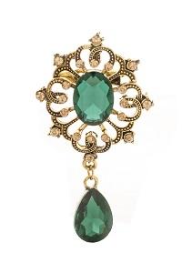 golden vintage brooch with emeralds
