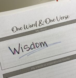 Denise M. Colby's Word of the year 2021 is Wisdom written out on a white piece of paper
