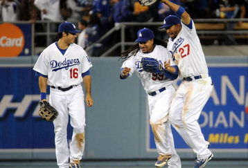 LOS ANGELES, CA - APRIL 30:  Matt Kemp #27 of the Los Angeles Dodgers celebrates a 8-5 win with Manny Ramirez #99 and Andre Ethier #16 over the San Diego Padres after the ninth inning at Dodger Stadium on April 30, 2009 in Los Angeles, California.  The Dodgers would win 8-5.  (Photo by Harry How/Getty Images)