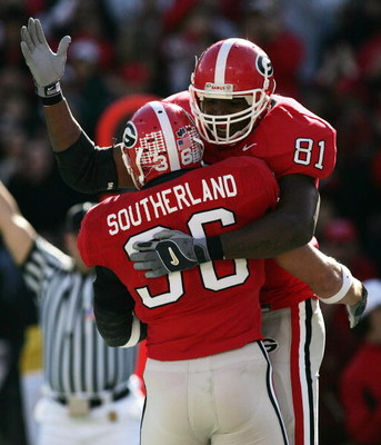 ATHENS, GA - NOVEMBER 19:  Tight end Leonard Pope #81 and Brannan Southerland #36 of the Georgia Bulldogs celebrate a touchdown by Southerland in the second quarter against the Kentucky Wildcats at Sanford Stadium on November 19, 2005 in Athens, Georgia.