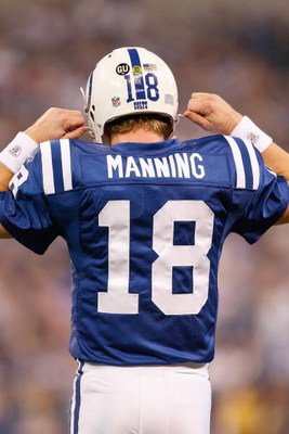 INDIANAPOLIS - DECEMBER 28:  Quarterback Peyton Manning #18 of the Indianapolis Colts unsnaps his helmet during the game against the Tennessee Titans on December 28, 2008 at Lucas Oil Stadium in Indianapolis, Indiana. (Photo by: Jamie Squire/Getty Images)
