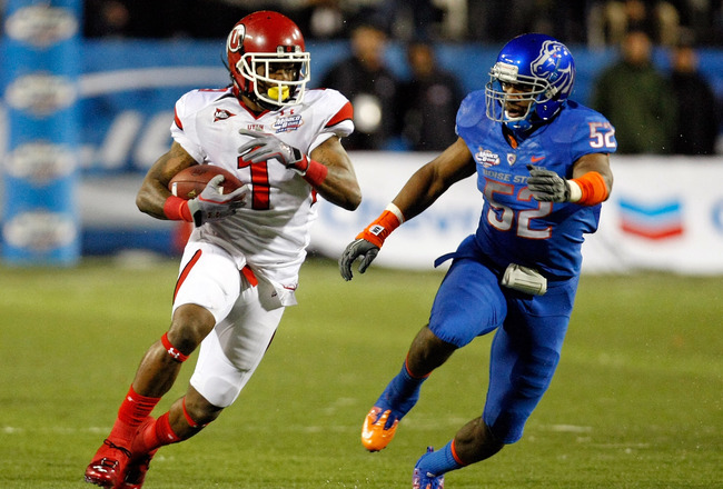 LAS VEGAS, NV - DECEMBER 22:  Shaky Smithson #1 of the Utah Utes runs for yardage against Derrell Acrey #52 of the Boise State Broncos during the MAACO Bowl Las Vegas at Sam Boyd Stadium December 22, 2010 in Las Vegas, Nevada. Boise State Won 26-3.  (Photo by Ethan Miller/Getty Images)