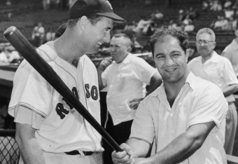 BOSTON - CIRCA 1955:  (UNDATED FILE PHOTO) Baseball legend Ted Williams (1918 - 2002) of the Boston Red Sox (L) laughs as American boxing great Rocky Marciano (1923 - 1969) swings a bat circa 1955. The 83-year-old Williams, who was the last major league player to bat .400 when he hit .406 in 1941, died July 5, 2002 at Citrus County Memorial Hospital in Florida. He died of an apparent heart attack.  (Photo by Getty Images)