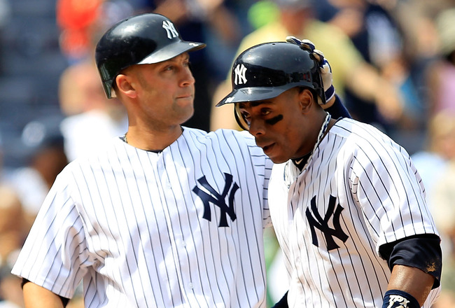 NEW YORK, NY - MAY 01: Curtis Granderson #14 of the New York Yankees is congratulated by his teammate Derek Jeter #2 after his three run homer in the fifth inning against the Toronto Blue Jays at Yankee Stadium on May 1, 2011 in the Bronx borough of New York City. (Photo by Chris Trotman/Getty Images)