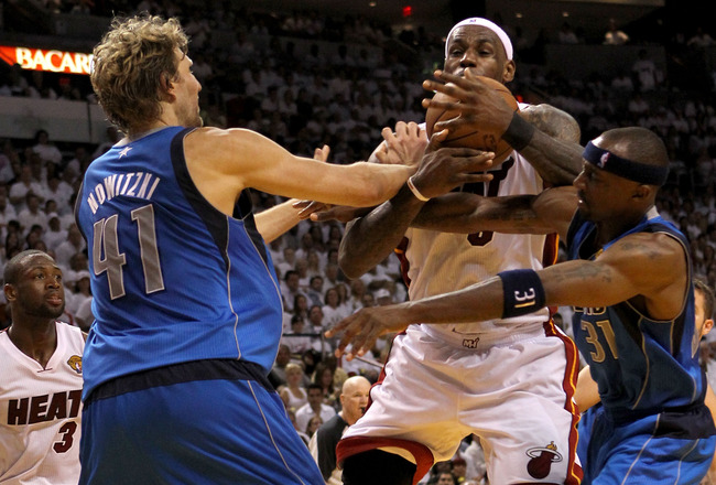 MIAMI, FL - JUNE 02:  LeBron James #6 of the Miami Heat drives between Dirk Nowitzki #41 and Jason Terry #31 of the Dallas Mavericks in the fourth quarter in Game Two of the 2011 NBA Finals at American Airlines Arena on June 2, 2011 in Miami, Florida. NOTE TO USER: User expressly acknowledges and agrees that, by downloading and/or using this Photograph, user is consenting to the terms and conditions of the Getty Images License Agreement.  (Photo by Ronald Martinez/Getty Images)