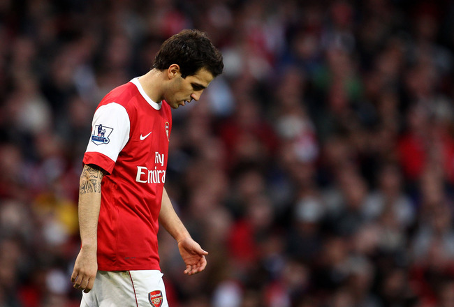 LONDON, ENGLAND - APRIL 02:  Cesc Fabregas of Arsenal walks dejectedduring the Barclays Premier League match between Arsenal and Blackburn Rovers at the Emirates Stadium on April 2, 2011 in London, England.  (Photo by Julian Finney/Getty Images)