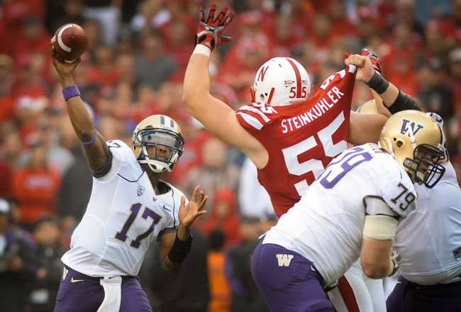 LINCOLN, NE - SEPTEMBER 17: Keith Price #17 of the Washington Huskies throws downfield over Baker Steinkuhler #55 of the Nebraska Cornhusker during their game at Memorial Stadium September 17, 2011 in Lincoln, Nebraska. Nebraska won 51-38.  (Photo by Eric Francis/Getty Images)