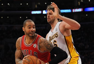LOS ANGELES, CA - DECEMBER 25:  Carlos Boozer #5 of the Chicago Bulls drives against Pao Gasol #16 of the Los Angeles Lakers at Staples Center on December 25, 2011 in Los Angeles, California.  NOTE TO USER: User expressly acknowledges and agrees that, by downloading and or using this photograph, User is consenting to the terms and conditions of the Getty Images License Agreement.  (Photo by Lisa Blumenfeld/Getty Images)