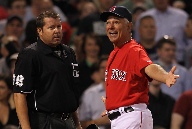 BOSTON, MA - JUNE 8: Bobby Valentine #25 of the Boston Red Sox argues with umpire Doug Eddings when Kevin Youkilis #20  was ejected in the sixth inning against the Washington Nationals at Fenway Park June 8, 2012  in Boston, Massachusetts.  Youkilis was ejected from the game. (Photo by Jim Rogash/Getty Images)