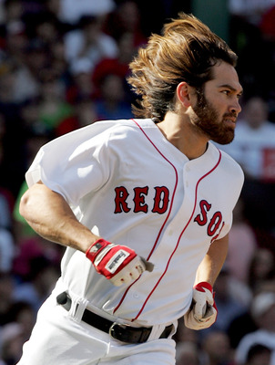 BOSTON - OCTOBER 02:  Johnny Damon #18 of the Boston Red Sox runs to first base during the game against the New York Yankees at Fenway Park on October 2, 2005 in Boston, Massachusetts.  (Photo by Jim McIsaac/Getty Images)