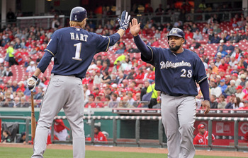 CINCINNATI - MAY 18:  Prince Fielder #28 of the Milwaukee Brewers is congratulated by Corey Hart #1 after Fielder scored in the first inning during the game against the Cincinnati Reds at Great American Ball Park on May 18, 2010 in Cincinnati, Ohio.  (Pho