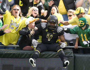 EUGENE, OR - NOVEMBER 6: Wide receiver Josh Huff #4 of the Oregon Ducks jumps into the crowd during the team introductions before the game against the Washington Huskies at Autzen Stadium on November 6, 2010 in Eugene, Oregon. The Ducks won the game 53-16