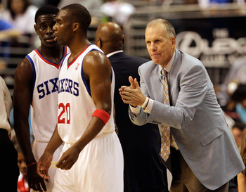 PHILADELPHIA, PA - APRIL 24: Coach Doug Collins of the Philadelphia 76ers gestures to players Jrue Holiday #11 (L) and Jodie Meeks #20 during the second half in Game Four of the Eastern Conference Quarterfinals in the 2011 NBA Playoffs at Wells Fargo Cent
