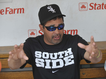 CHICAGO, IL - JULY 03:  Manager Ozzie Guillen #13 of the Chicago White Sox  talks to the media before the Chicago Cubs game on July 3, 2011 at Wrigley Field in Chicago, Illinois.  (Photo by David Banks/Getty Images)