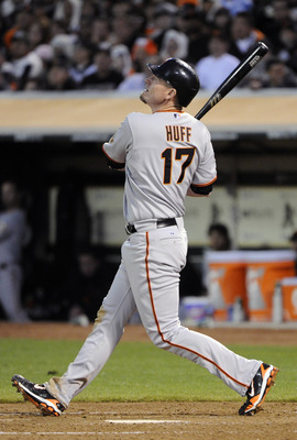 OAKLAND, CA -  JUNE 18: Aubrey Huff #17 of the San Francisco Giants hits a sacrifice fly in the fifth inning to score Andres Torres #56 against the Oakland Athletics during a MLB baseball game June 18, 2011 at the Oakland-Alameda County Coliseum in Oaklan