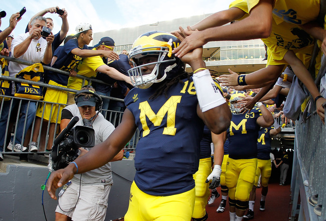 ANN ARBOR, MI - SEPTEMBER 10:  Denard Robinson #16 of the Michigan Wolverines takes the field for warmups prior to playing the Notre Dame Fighting Irish at Michigan Stadium on September 10, 2010 in Ann Arbor, Michigan. (Photo by Gregory Shamus/Getty Image