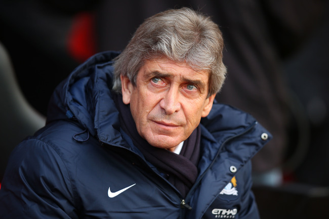 Hi-res-454115561-manchester-city-manager-manuel-pellegrini-looks-on_crop_650
