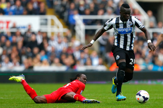 Hi-res-185345977-cheick-tiote-of-newcastle-in-action-with-victor-moses_crop_650