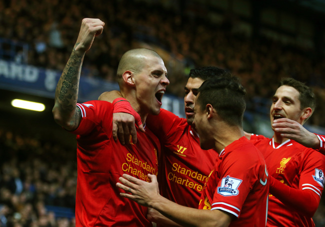 Hi-res-459716489-martin-skrtel-of-liverpool-celebrates-with-teammates_crop_650