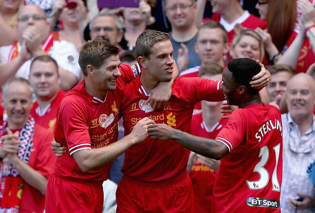 Hi-res-175375234-jordan-henderson-of-liverpool-is-congratulated-by_crop_650