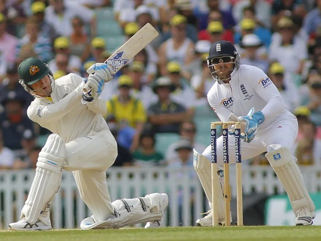 Michael Clarke plays a shot as Matt Prior looks on during the Investec Ashes cricket match between England and Australia played at The Kia Oval Cricket