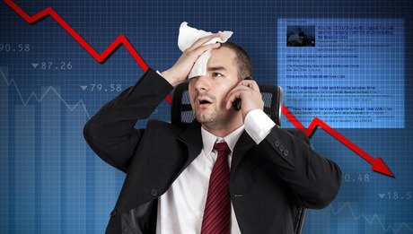 Financial crisis. Broker holding forehead